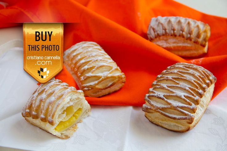 Yellow cream pastry on orange and white