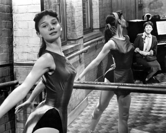 Audrey Hepburn practicing at the barr c. 1949
