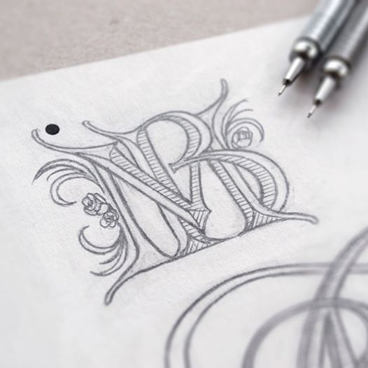 I love how it's intertwined and has the feeling of old calligraphy. Wedding monogram sketch by Jackson Alves