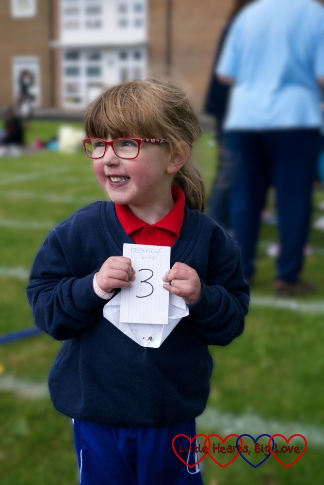 Jessica with her 3rd place sign for the obstace race