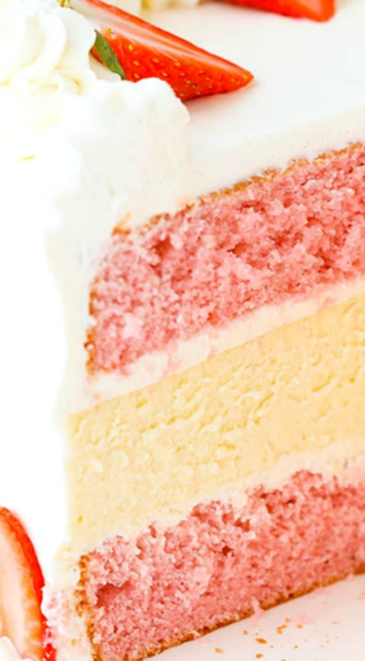 Strawberries and Cream Cheesecake Cake ~ Two layers of strawberry cake and a creamy layer of vanilla cheesecake in the middle... This cake is delicious and hardcore. True cake lovers – please proceed.