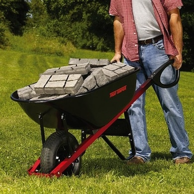 A modernized version of the classic wheelbarrow, this steel-construction model from Ames features ergonomic handles for superior control and maneuverability, and with six cubic feet devoted to hauling, it can handle your heaviest loads with ease.