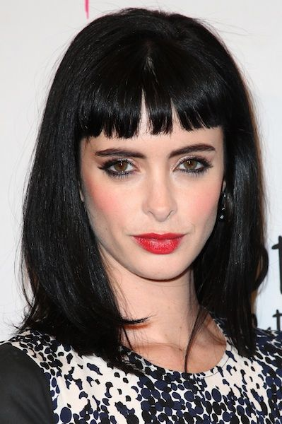 Krysten Ritter wears straight bangs and bright red lipstick to the red carpet. Photo courtesy WENN