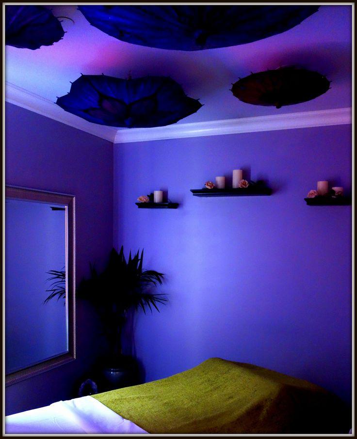 Massage room with parasols.  Designed by Rose Nadali at Cienega Spa