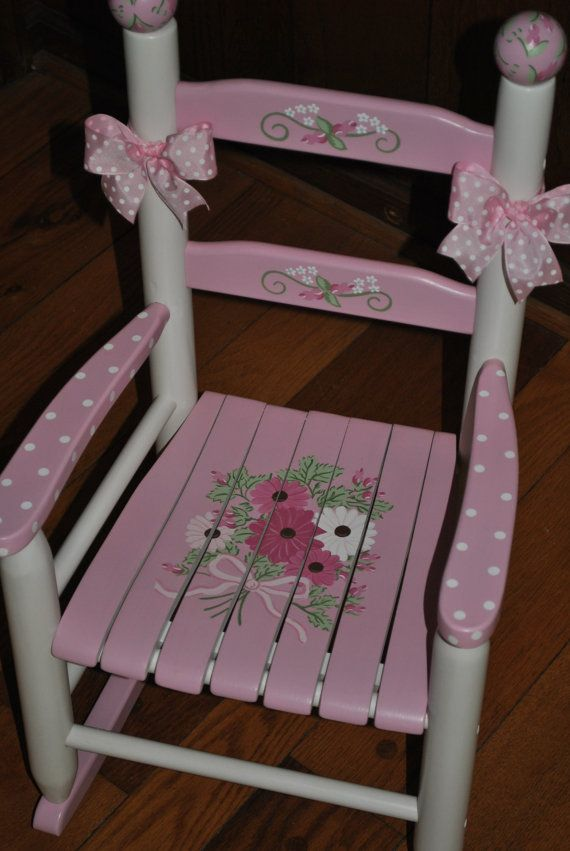 """MAKE A LITTLE GIRLS NURSERY SOMETHING SPECIAL  Hand painted childrens rocking chair. Solid wood construction with hand painted wooden finials and ribbon trim included.  ALL ROCKING CHAIRS CAN BE """"PERSONALIZED"""" AT NO EXTRA CHARGE.  All paints and finishes used are lead-free and non-toxic, and the solid hardwood construction is designed to last. Rocking chairs are completely finished with several coats a durable polyurethane finish making it easy to clean.  PLEASE NOTE: DUE TO NEW SHIPPING…"""