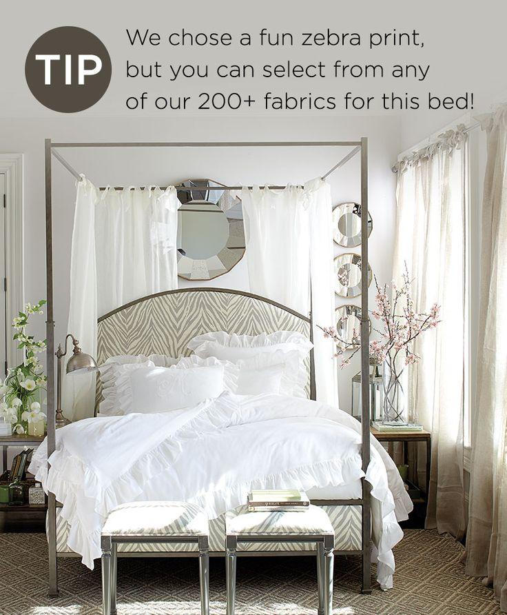Gray bedroom with zebra print canopy bed