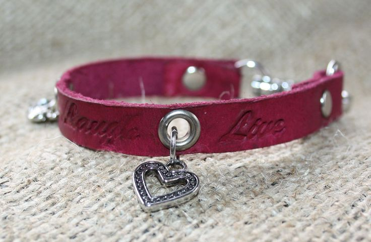 """A 3/8"""" leather bracelet dyed red and stamped with the words Love, Laugh, Live and two heart charms.  Finished with a spring clip closure.   http://shop.sydenhamhillfarm.ca/products/live-laugh-love-bracelet"""