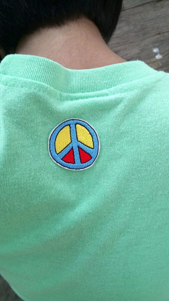 Check out this item in my Etsy shop https://www.etsy.com/listing/499710636/cute-colourful-peace-symbol-iron-on