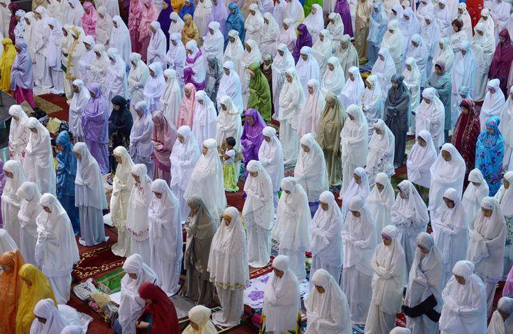 Indonesian Muslim women performing Taraweeh Salat (Night Prayer)  on the first night of Ramadan at the Istiqlal mosque in Jakarta, on July 9, 2013.