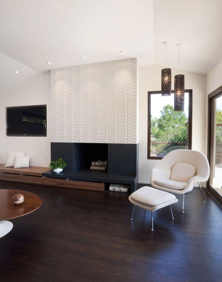 Angolo living con zona relax. Vari elementi del design molto particolare: camino aperto, disegno rivestimento, nicchia per inserire la tv