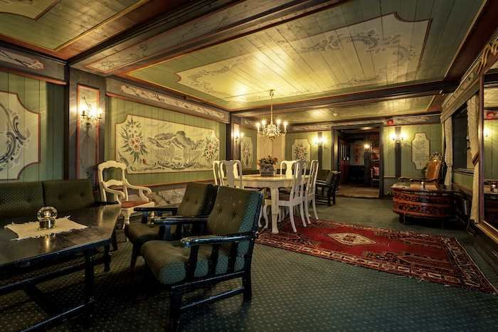 Cosey wood panelled lounge at Bergo Hotel