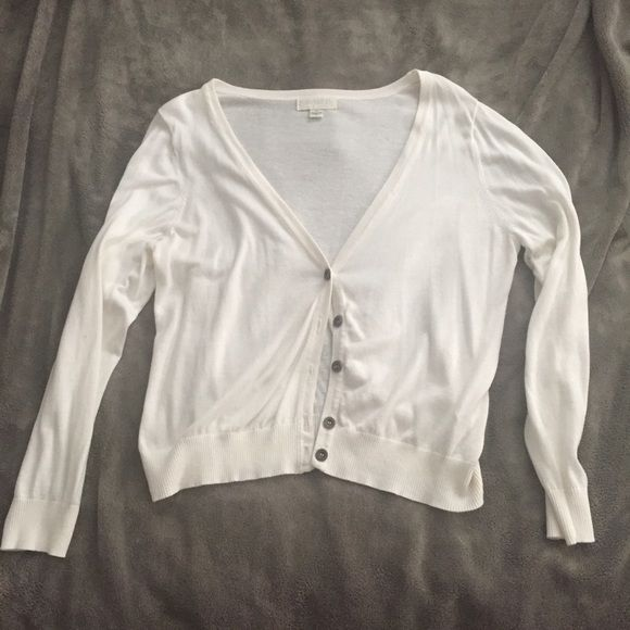 F21 Short White Button-up Cardigan F21 white button up cardigan (short version) 3x. Soft material. Never worn but tag was removed. Great to dress up or down! Forever 21 Sweaters Cardigans