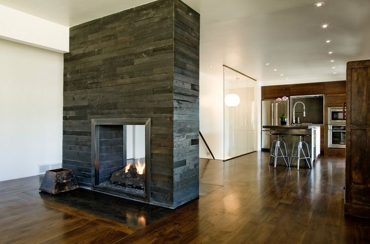 love the idea of have a fireplace in the center of an open floor plan