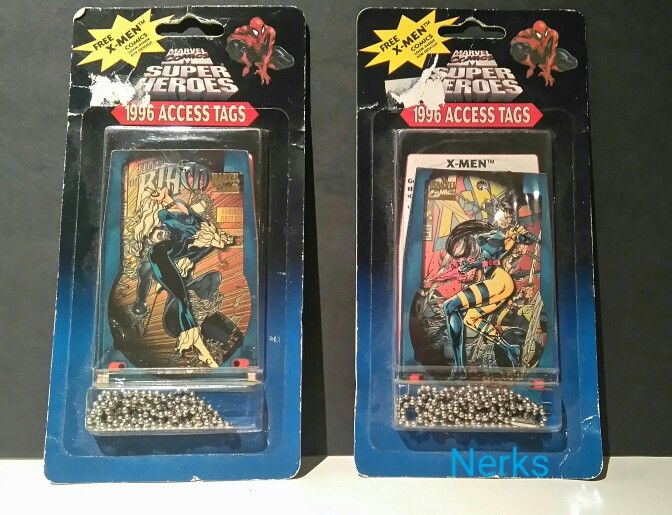 Black cat, psylocke 1996 Marvel access tags, unopened packs. $6.00 for both or $4 each CDN +ship.