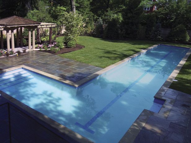This pool by  High Tech Pools  in Ohio offers swimmers a lap lane and a cozy splash zone.