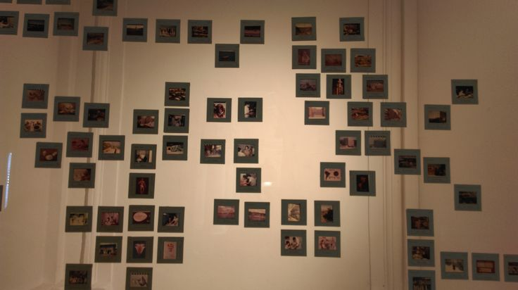 """Camila Estrella (CL) """"Imágenes para educación de adultos"""" 2016 Instalación Fotográfica Diapositivas originales, acrílico, rollos de película, collage de diapositivas y negativo, vidrio. Dimensiones Variables"""
