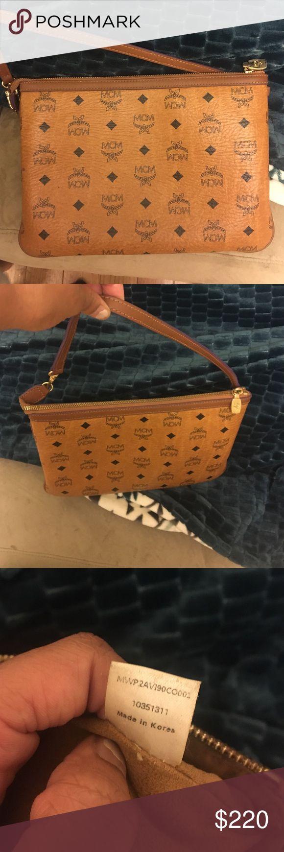 Mcm clutch Mcm clutch bag slightly worn. Purple trim MCM Bags Clutches & Wristlets