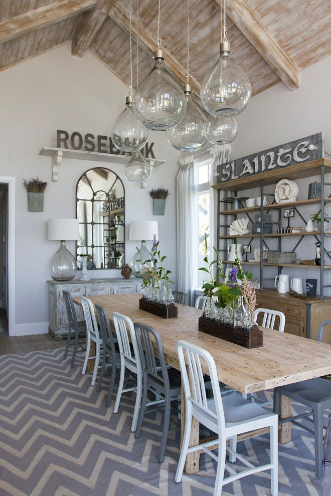 Farmhouse Coastal Dining Room with whitewashed ceiling planks, jar pendant lights and farmhouse table. Heritage Homes of Jacksonville. Villa Decor & Design.