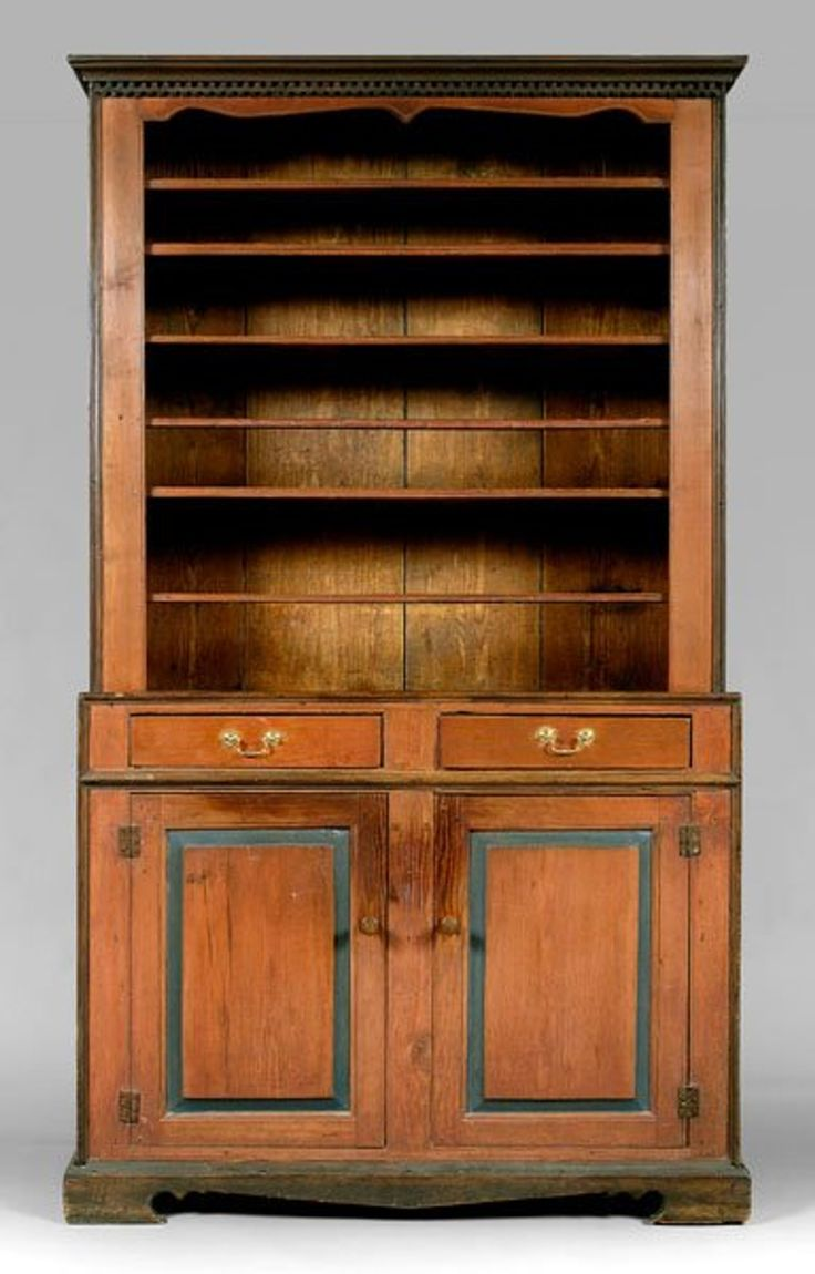 252:flat cupboard, attributed to Jacob Sanders School, single-case construction with shaped and dentil-molded cornice, upper case with four fixed shelves with molded fronts, one with spoon openings, two plate rails, one with spoon openings, over two original drawers with cut-nail construction and two panel doors, original peaked apron skirt and bracket feet, undisturbed backboards with rosehead nails, Troy, Montgomery County, North Carolina, 1780-1810, 86 x 49-1/2 x 18-1/2 in.