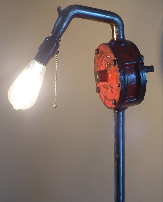 This former Monarch Machinery Co Ltd water pump from Winnipeg in Canada , was discovered by me lying in a horse paddock in southern British Columbia. I decided not to straighten the stem but to leave it in its as found state and finally came up with the idea to use horse shoes for the base . This feature floor lamp gives me a favourite combination of art and a practical piece of furniture. 4ft high provides a great room feature .