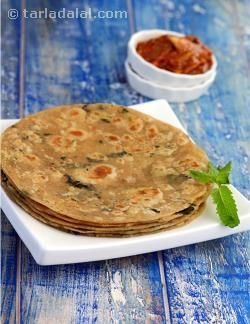 Thought you could use Pudina only to make raitas or refreshing drinks? Think again! The Punjabis are known for their ability to use every ingredient in every form and make a variety of dishes from them all with a unique taste and flavour. Dried Pudina is used in this Paratha recipe. Instead of mixing the Pudina into the dough it has been sprinkled on top after the Paratha has been rolled out. This makes the Paratha look great once cooked and its yummy fragrance spreads all over, taking every…