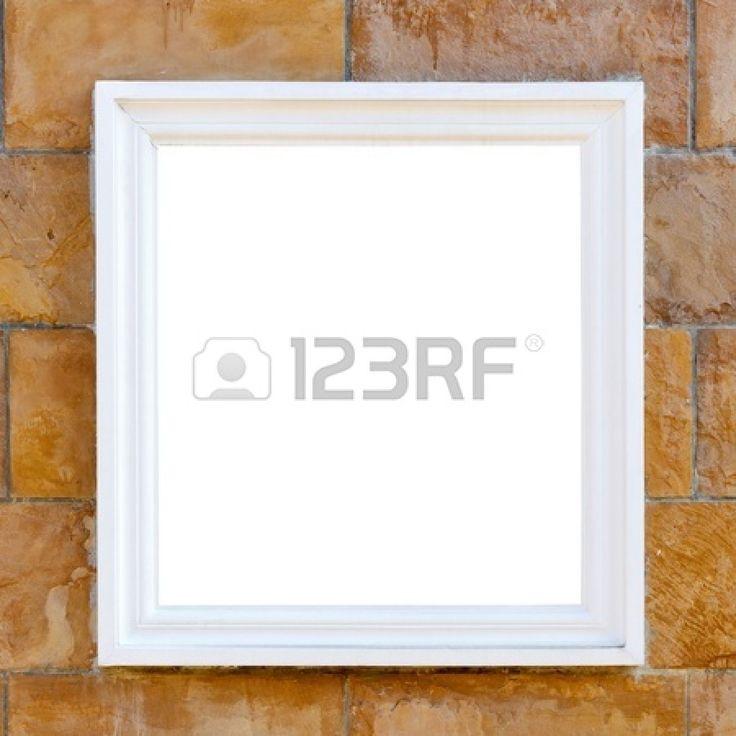 большая белая рамка на кирпичной стене Фото со стока