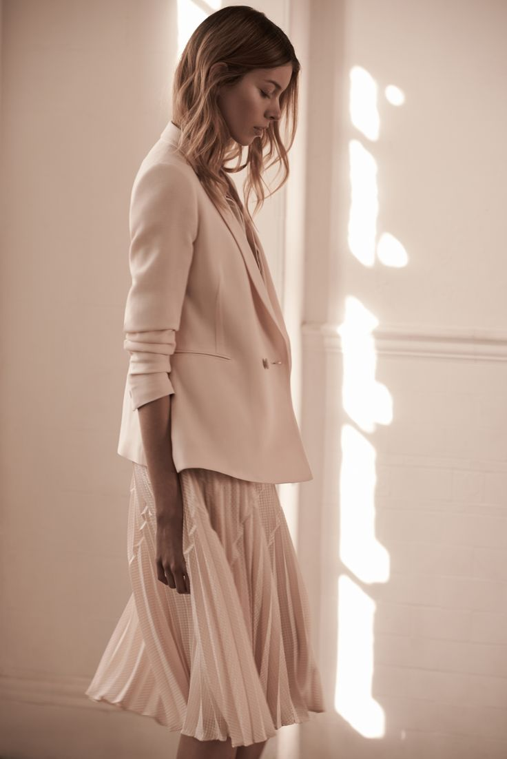 Womenswear Tailoring The Modern Edit :: Keep smart dressing relevant by balancing the fluid lines of a knife-pleat midi skirt with a boxy double-breasted blazer