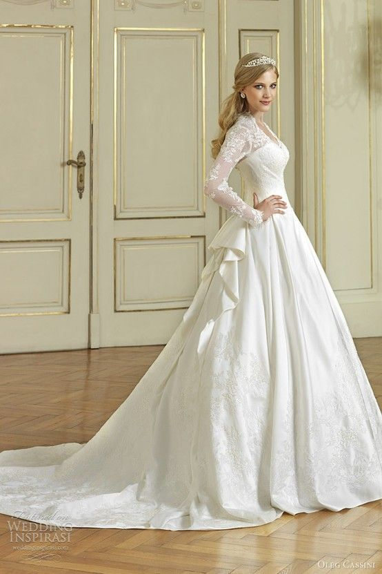 Long sleeve lace and satin V-neck ball gown. Really like the top of this