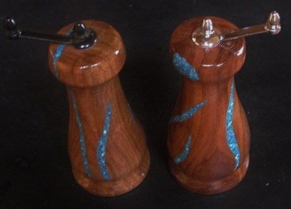 "Salt & Pepper Mill Set. Mesquite Wood inlaid with Turquoise. Approximately 3""x7"". Ceramic grinding mechanisms for fine to course grind. Easy fill from the top."