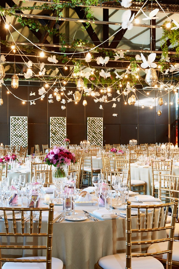 Warm and charming. It really invites you in, like a secret garden. I love the centerpieces and fairy lights on the canopy.