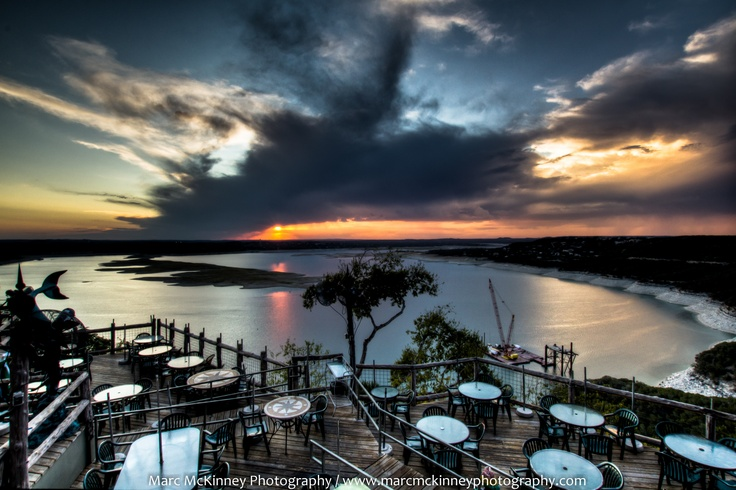 Lake Travis – Austin, Texas – as seen from the Oasis Restaurant. One of the best places to watch the sunset. When it goes down each night, the crowd applauds. The OASIS restaurant has the reputation as the largest outdoor restaurant in the state of Texas and, most likely, in the country.