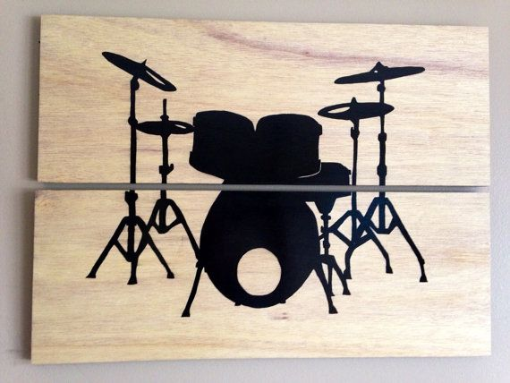"""The 2 piece light wood art canvas takes a minimalist approach to make the """"drum love"""" shine.  The silhouette is painted in black which contrast nicely against the light wood grain background."""