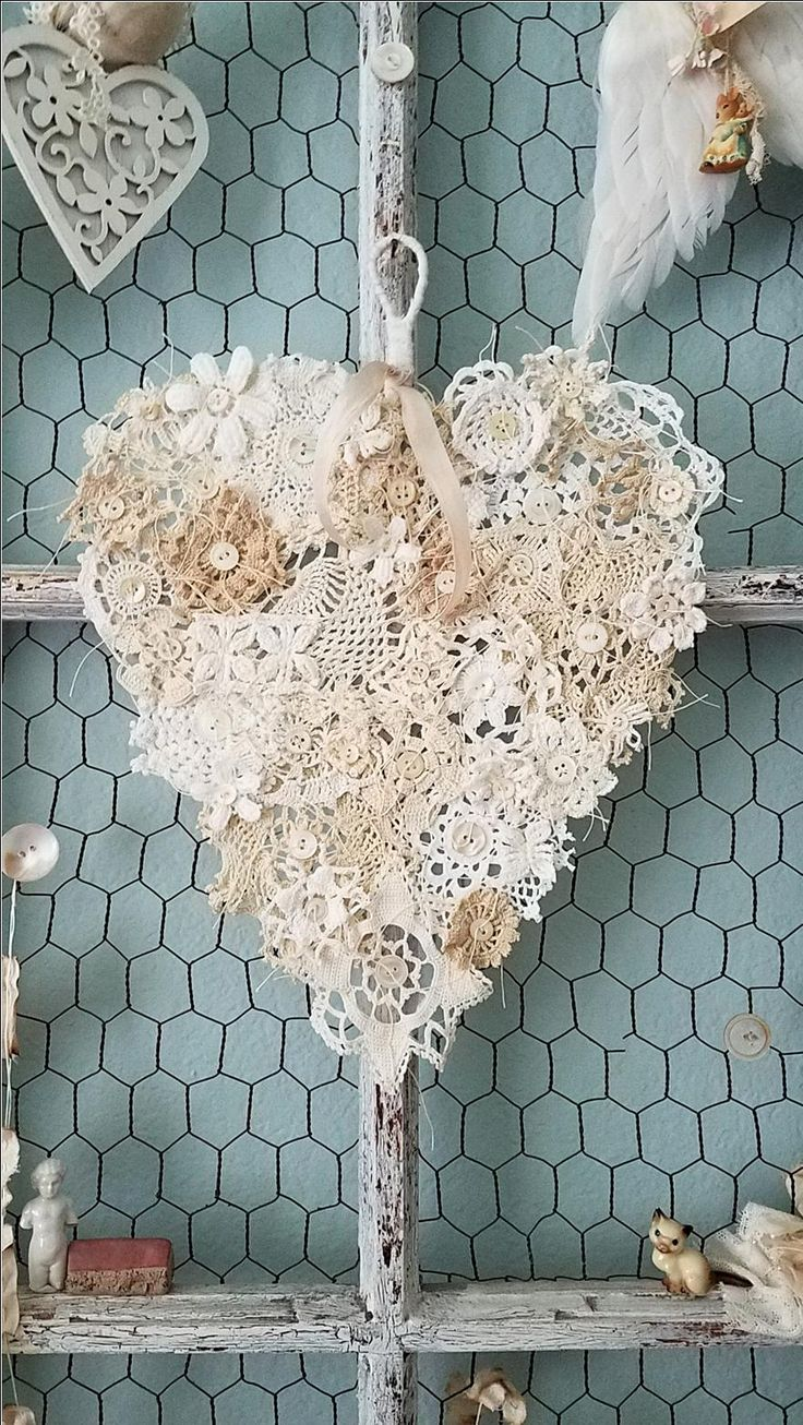 This gorgeous heart is a Shabby Chic dream of a heart! An abandoned wire hanger was hand tugged and pulled into a not so perfect heart, like our own then wrapped with tattered and torn strips of vi...