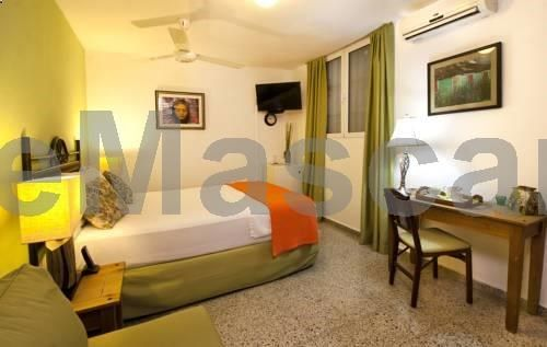 Hostal Midway Santo Domingo Located in Santo Domingo, 800 metres from Malecon, Hostal Midway features air-conditioned rooms and free private parking. Guests can enjoy the on-site bar. Each room has a TV. Certain rooms include a seating area where you can relax.