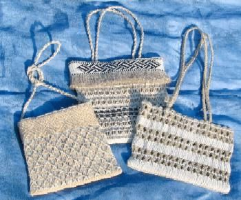 Unbleached cotton kete with woven taniko bands stitched to the bags. These bags were made for using