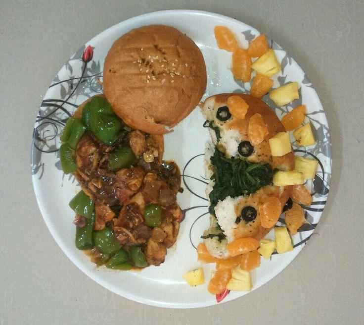 Chicken Manchurian burger & focaccia oregano with Vegies n fruits.