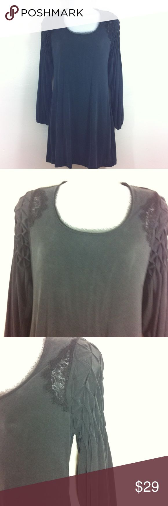 Stunning charcoal grey dress by Free People Charcoal grey mini dress. It has old world charm in the sleeves and lace insets by sleeves in from and back. Slightly sheer fabric. Gently worn and no flaws Free People Dresses