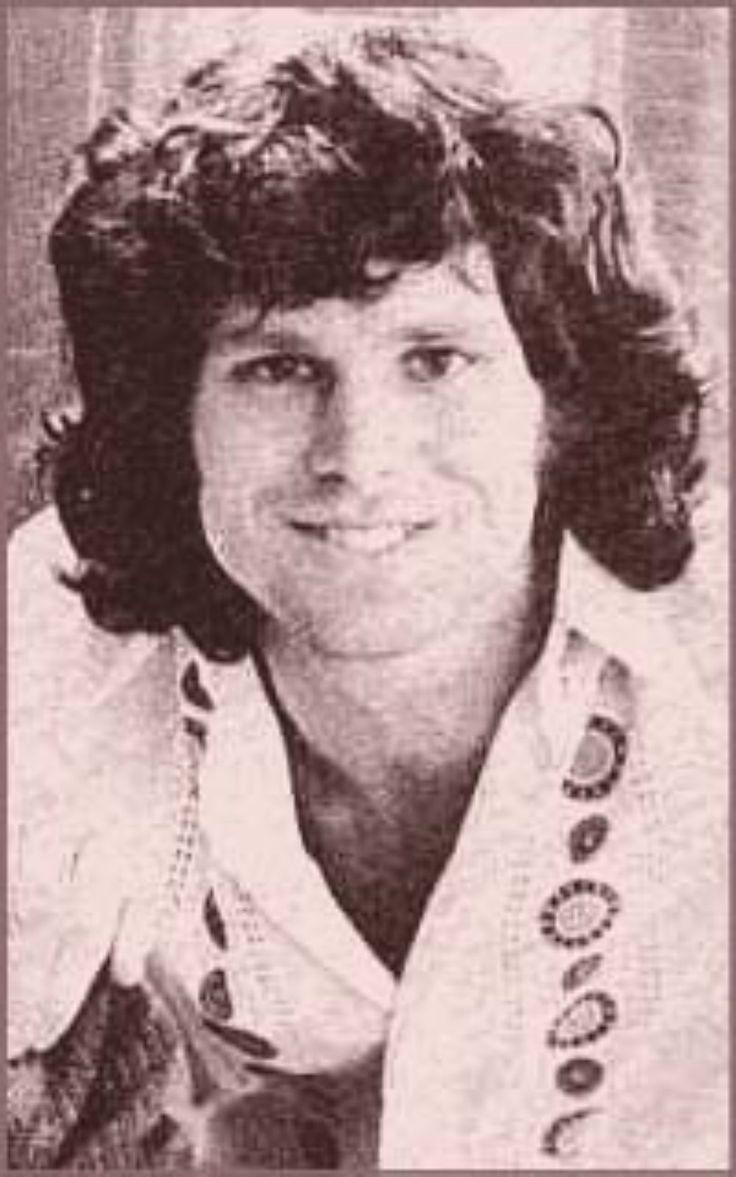 Jim Morrison, oh that smile again.  (The Doors)