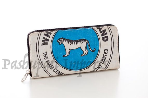 This is a lovely eye catching ladies wallet with a vibrant blue, white and black tiger design. Hand made from recycled cement bags, it is high
