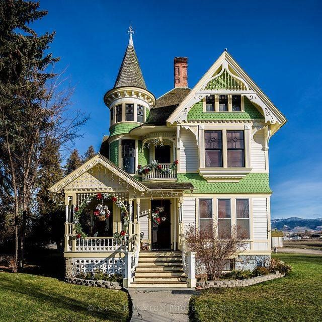 This little Victorian cottage has it all; porch, turret, balcony and gothic inspired roof lines