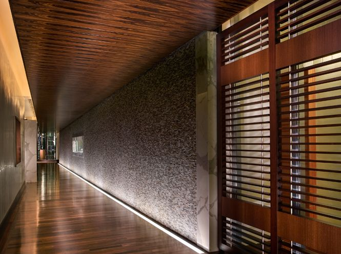 """Plain sliced Santos Rosewood ceiling at """"Forced Perspective"""" corridor to restaurant entry. One Bal Harbour,  A Regent Hotel, Bal Harbour, Florida"""