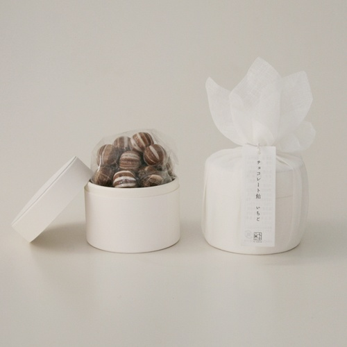 container wrapped in tuile with imprinted ribbon