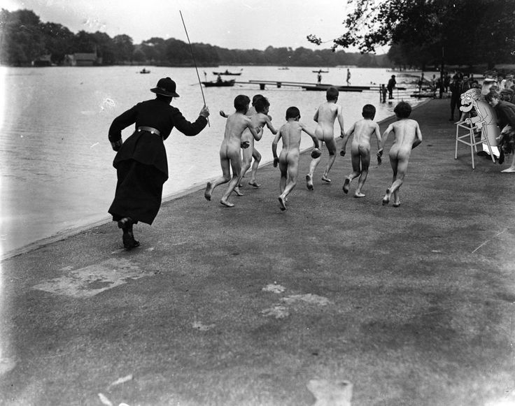 A policewoman chases a gang of skinny dippers down the street at Hyde Park, 1926