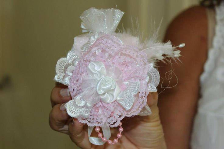 Organza bag with a pretty lace arrangement attached. Pink soap inside