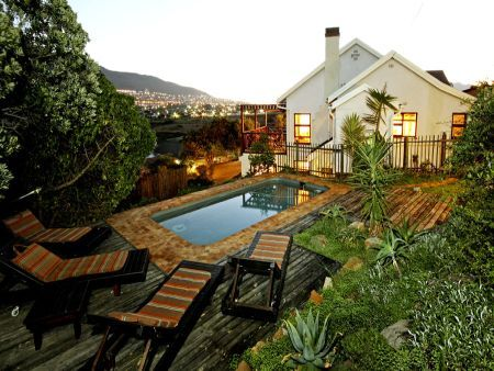 Self catering accommodation, Clovelly, Cape Town, South Africa  Enjoy an evening sunset dip in the backyard pool