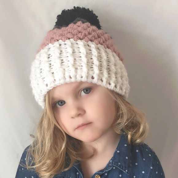Crochet Puff Stitch Beanie Stylish twist on the classic crochet beanie. Ribbed band for added texture and contrast against the puff stitch. Perfect fall/winter accessory! This beanie was made with 4 colors of super soft and warm acrylic yarn. Colors shown are white, dusty rose, deep gray and black for the Pom Pom. One size fits most - both my three year old and I can wear it. Color can be customized, just shoot me a message! Can be made with or without pompom city willow Accessories Hats