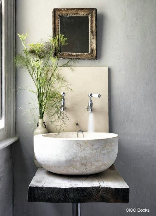 Stone wash basin in a gray bathroom