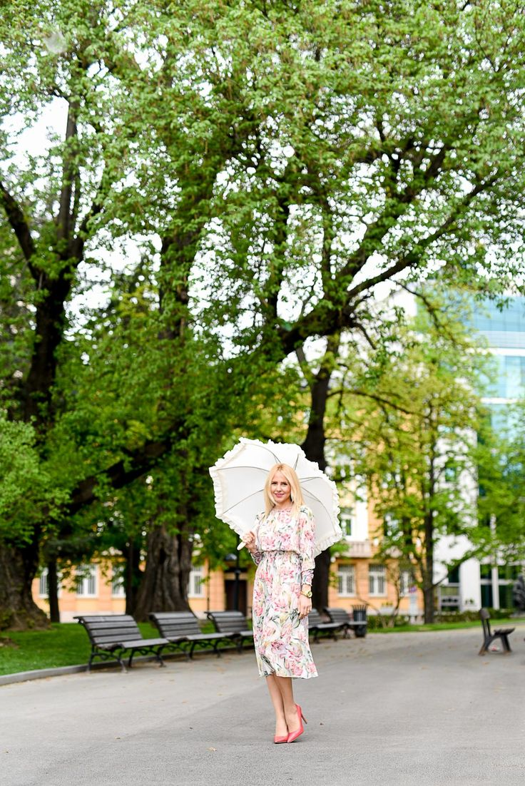 ✳ New free photo at Avopix.com - Woman in White Green and Red Floral Holding White Umbrella on Gray Concrete Pathway Near Brown Wooden Bench Near Trees during Daytime    🏁 https://avopix.com/photo/45767-woman-in-white-green-and-red-floral-holding-white-umbrella-on-gray-concrete-pathway-near-brown-wooden-bench-near-trees-during-daytime    #tree #landscape #summer #forest #grass #avopix #free #photos #public #domain
