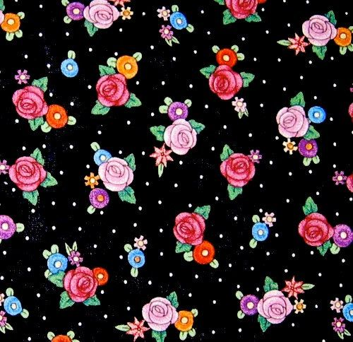 "1 yard and 34"" of Mary Engelbreit OOP fabric- Multicolored flowers and white dots on black print. $13.60, via Etsy."