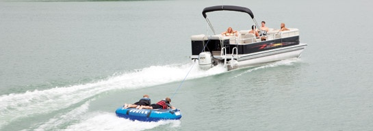 Go tubing from your Avalon pontoon boat for a fun and fast ride! #avalonpontoons #pontoonboats #tubing